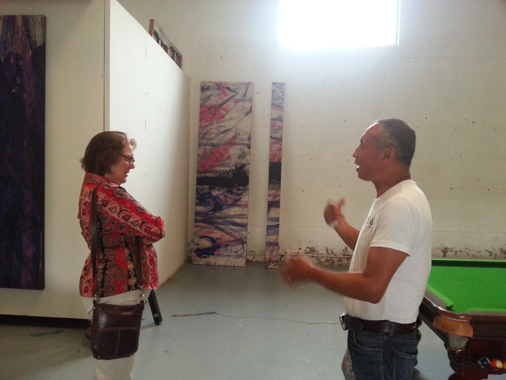 Zhang Wei in his studio explaining his technique to us