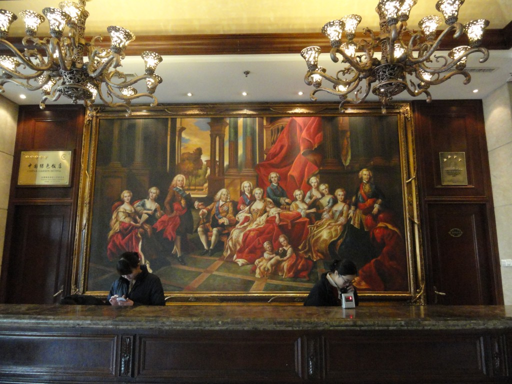 front desk of Tehall Hotel showing large oil painting